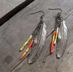 Coral Mustard Beaded Feather Earrings...so western chic i'm dying.