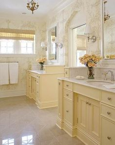 Soft yellow woodwork color for parents already yellow tiled bathroom