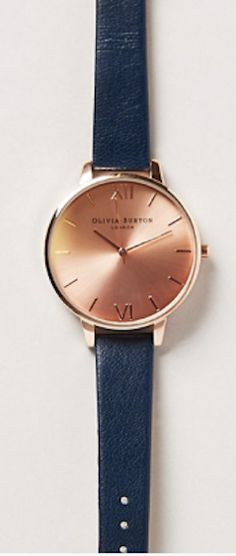 love the dark blue straps with rose gold face http://rstyle.me/n/juunmr9te