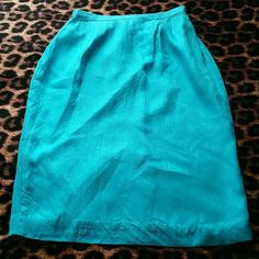 Nice Vintage Skirt Midi vintage skirt in pretty blue color. Silk material. Waist does have elastic in back with stretch. Clasp closure and zipper in back. Split in back. Bought from boutique but too small. Does have lining. Length 25 inches. Waist 12 1/2 without stretch. Skirts Midi