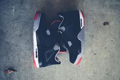grey, black, red and white - Jordans