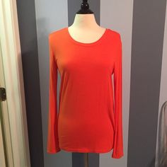BCBG orange knit top Never worn! Paper tag is gone but black BCBG tag is still attached. Fits like a medium. BCBG Tops