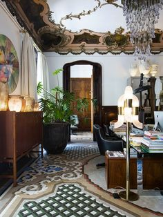 Catalan Modernism by Lauren in Home All of the wonderfully eclectic details, that make up Lázaro Rosa-Violán's home in Barcelona, are to die for. Though the 4,000-square-foot, Art Nouveau style home was rather neglected when it was purchased by the interior designer, it was filled with an insane amount of original details like stained glass windows, intricately tiled floors, carved oak panels and ornate ceiling moldings. And I just love that Lázaro layered on the design with furniture of a…