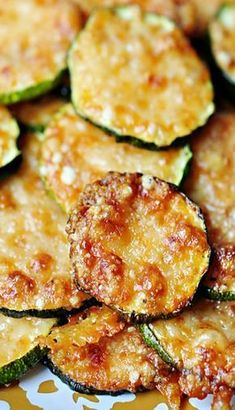 """""""Baked Parmesan Zucchini Rounds"""" Made these tonight to accompany our steak and salad dinner. Soooo good and easy. Finally a delicious go to recipe for the piles of zucchini my neighbor gives us! Side Dish Recipes, Vegetable Recipes, Low Carb Recipes, Vegetarian Recipes, Dinner Recipes, Cooking Recipes, Healthy Recipes, Free Recipes, Dessert Recipes"""