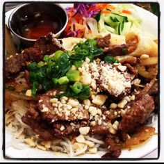 Vietnamese rice noodles with grilled beef, peanuts and fish sauce :)