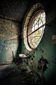 Gorgeous Abandoned Building | Round Window | Green Paint | Home Decor Inspiration