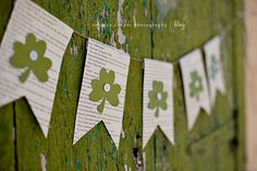 St. Patrick's Day Bunting.  Upcycled book pages, green paper, and buttons!