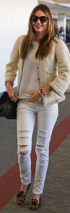 Miranda Kerr: Jacket – Chanel  Sunglasses – Stella McCartney  Jeans- Mango  Purse – Valentino  Shoes – Prada  Ring – Anita Ko  Watch – Longines La Grande