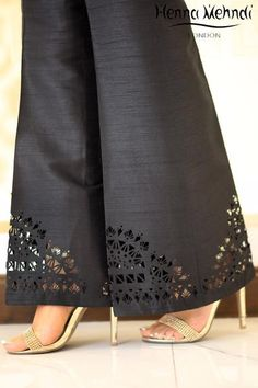 Black raw silk trousers with cut work. Available in trousers or boot cut trousers. Can be ordered in white colour. Please note these are trousers only. Please n text Black Raw Silk Cutwork Trousers Salwar Designs, Blouse Designs, Dress Designs, Plazzo Pants, Fashion Pants, Fashion Outfits, Mode Abaya, Cut Work, Pants Pattern