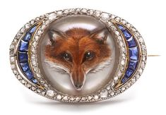 """Circa 1900, this brooch is a beautiful example of """"reverse crystal"""" jewelry. Reverse crystals became popular in England during the second half of the 19th century, and they're created by carving an intaglio into the flat back of a cabochon-cut crystal."""