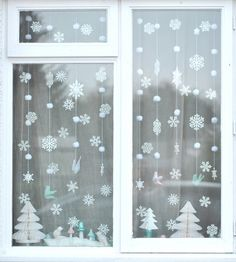 Mini pom pom snowballs ~ Torie jayne // Winter wonderland window, via Flickr.