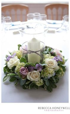 Floral ring with hurricane vase and candle.- Floral ring with hurricane vase and candle. Roses, Hydrangea and Freesia. Floral ring with hurricane vase and candle. Roses, Hydrangea and Freesia. Candle Arrangements, Candle Centerpieces, Wedding Flower Arrangements, Floral Centerpieces, Wedding Centerpieces, Floral Arrangements, Wedding Decorations, Candles, Table Decorations