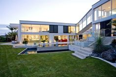 the house is in modern design, consist of two wings that linked by a bridge, and complemented by an infinity pool