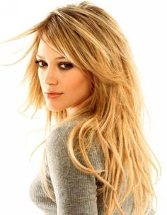 @Suzanne, with a Z. Romero cut your hair like this!  Hilary Duff: long layers, sideswept bangs