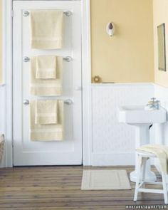 Hang Towel Bars on Back of Door : great way to hang towels in a bath or extra blankets in a bedroom... saves space too! - 30 Brilliant Bathroom Organization and Storage DIY Solutions