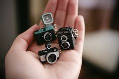 Miniature cameras, not the right scale but very cute!