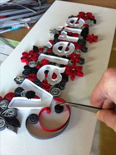 Name table quilling in progress - Quilling Paper Crafts Quilling Letters, Paper Quilling Jewelry, Origami And Quilling, Paper Quilling Patterns, Quilled Paper Art, Quilling Paper Craft, Paper Crafts, Quilling Ideas, Quilling Tutorial