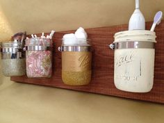 Mason Jar Wall Storage/Organizer- this is for sale on Etsy but I think it would fairly simple to make and what a great idea!