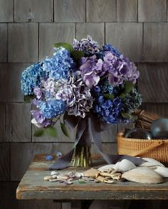 Shades of blue color scheme with rustic tables and scattered sea shells