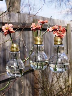 Beautiful Hanging Glass Light Bulb Vase.  Perfect For A Spring/Summer Wedding. via Etsy