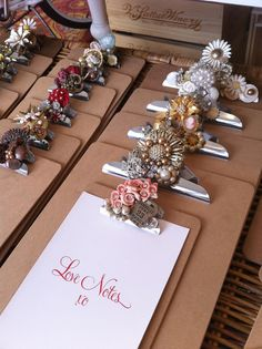 More clipboards with bling (created by Love Notes) They have clipboards at the dollar store now, these might make a great affordable and practical favor as well as useful at the event. Could decorate simply on boards too. Could also be hung or set at tables to hold information and signs as an inexpensive way to decorate.