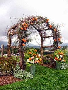 Rustic arbor covered with roses (would like it even better if they were mini pumpkins)