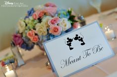 "Reception tables with Mickey and Minnie silhouette placecards with sayings like ""Meant to Be,"" ""Magic Happens"""