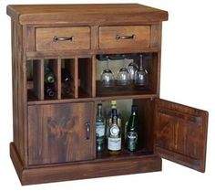 Beautiful, solid bar in a rustic style. With 2 top drawers, ample space for wine bottles, and glasses. 2 doors at the bottom for liquor bottles and accouterments  Made from recycled lumbar, as all other wooden products created by 2 Day Designs. Some pieces of wood may bear the original branding and handling marks of the vineyards they are from. With a unique and interesting history, this  2 Day Designs Wine Bar on Casters makes for a great conversation piece to share among friends and family…
