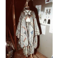"""""""Abstract"""" ensemble. Bandeaux with an exaggerated gathered skirt and an oversized kimono."""