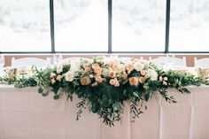 Calgary Wedding Flowers- 5 foot long head table arrangement with cascading eucalyptus and Italian ruscus foliage with peach garden roses and hydrangea  Photo: @heartsparrow   www.flowersbyjanie.com  Flowers by Janie- Calgary Wedding Florist