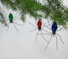 Paint vintage Christmas tree light bulbs black and add wire for wiggly spiders