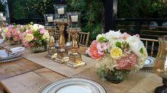 Elegant wedding centerpiece. Features peonies,  roses, lisianthus, hydrangea and seeded eucalyptus. Petal Town Flowers