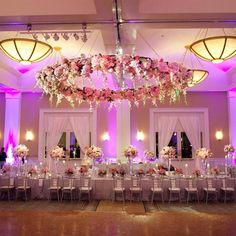 large floral arrangement hanging from celling and love the colour palette also the lighting