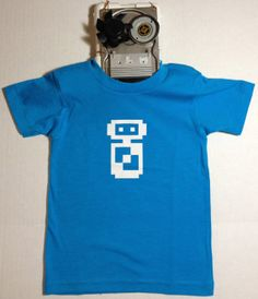 Whether you love 8-Bit nostalgia or Robots this tee is sure to please. Each 8-Bit Bot is placed on a 50/50 (cotton/polyester) American Apparel tee.  8Bit Robot TShirt by TheVintageRobot on Etsy, $16.00