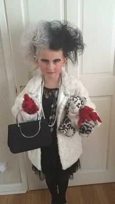 dressed as Cruella De Vil from 101 Dalmatians. Black dress and tights, old white beads, black handbag. Eyeliner for eyebrows, old winter fur coat. Lots of back combing and hair spray finished with hair spray colours Book Costumes, World Book Day Costumes, Book Character Costumes, Book Week Costume, Dress Up Costumes, Girl Costumes, Fancy Dress For Kids, Kids Dress Up, World Book Day Ideas