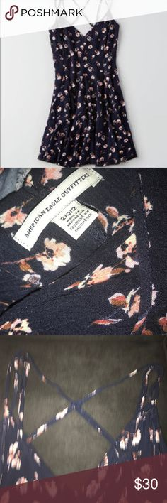 American Eagle floral dress This is a navy floral dress from American Eagle!! It has light pink and white flowers!! It flows right above your knees and is in really good condition!! American Eagle Outfitters Dresses