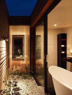 I love the sliding glass door and privacy for the soaking tub!!  Villa Bergman Werntoft - Johan Sundberg Arkitektur i samarbete med Laine Montelin, Tyréns. Fotograf: Peo Olsson. 2005-2006.