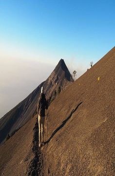 Volcán de Fuego is an one hour bus ride from Antigua, Guatemala. Hike up the of Volcano Acatenango to see the active Volcano Fuego erupting. Active Volcano, Bus Ride, Monument Valley, Hiking, Mountains, Nature, Travel, Antigua, Volcanoes