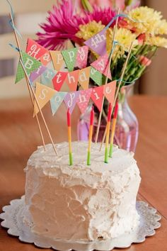 How to make a cake bunting:  I just do NOT decorate with frosting. I can't write a cake message without it looking like a 2 year old did it. If I was going to go through all the effort to making a cake, the darn thing better look good on the outside as well!  super cute