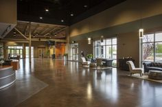 Spaces defined by area rugs & very nice floors in this warehouse church lobby - Google Search