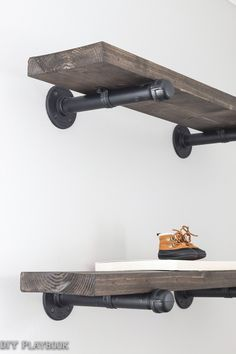 DIY Industrial Pipe Shelves - DIY Playbook.  Shelves also in the living room at: http://thediyplaybook.com/2016/08/diyplaybooksos-lisas-living-room-space.html