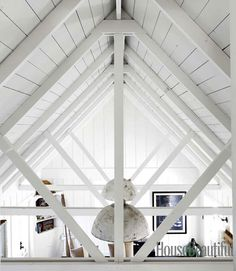 Dempster was drawn to the cathedral ceiling in the living room. Alec Hemer  - HouseBeautiful.com