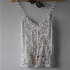 Lovely White Lace Criss-Cross Spaghetti Strap Top This cute top was from Hollister and has only been worn once-- no stains, no tears and in perfect condition. Can be paired with boyfriend jeans, leggings, cute glasses, (really anything)! Perfect addition to your closet. Hollister Tops Blouses