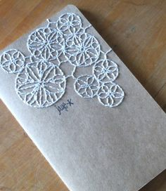 stitching on a notebook -- interesting