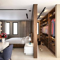 Walk-in wardrobe with a partition in the bedroom. #interiordesign #interiordecor #interiordecorideas #bedroomdesign #walkinwardrobe #partition #tracklight #spacelit #instainteriors #instadaily #instagood