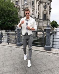 Street style with white denim jacket gray chinos white sneakers striped shirt and sunglasses #streetstyle #streetwear #menswear #casualstyle #casual #denimjacket #menfashion
