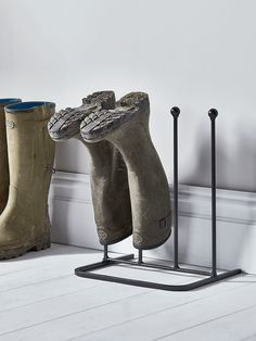 An essential for any hallway or porch, our classic two-pair boot rack is the perfect tool for storing muddy boots of all sizes. Made from durable and weather resistant cast iron, each rack includes four high spokes with rounded ends and a semi-circular base that's sturdy but can be placed against a wall. Need more space? Take a look at our Four Pair Metal Boot Rack.