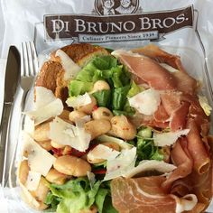 My favorite salad! Di Bruno Bros: escarole, prosciutto, shaved sharp prov, jumbo butter bean salad, crostini, lemon vinaigrette.