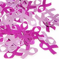 """Pink Ribbon Confetti by Century Novelty. $2.75. Show your Courage and Strength with Pink Ribbon Decorations! The pink ribbon confetti is the perfect breast cancer awareness decoration. Use pink ribbon decorations like these to decorate at your next Breast Cancer Awareness banquet or event. One ounce bag of confetti. 3/4"""" long pink ribbon shapes. Assorted light and dark pink shades. These breast cancer awareness decorations and pink ribbon tableware are the perfect touch to ..."""