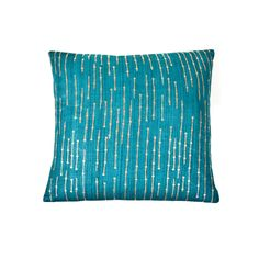 Add a pop of contemporary color to any room with this Sequins Teal decorative throw pillow. This pillow is made of 100-percent silk with a luxurious feather fill and flap closure.